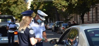 COPIL IUBIT LA BORD: acțiunile polițiștilor în trafic.